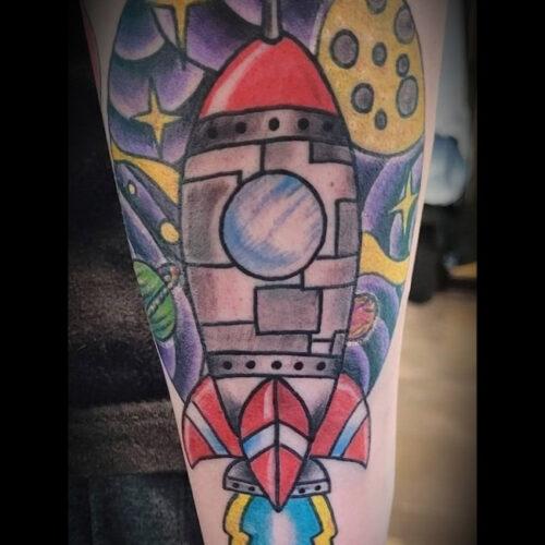 rocket ship tattoo
