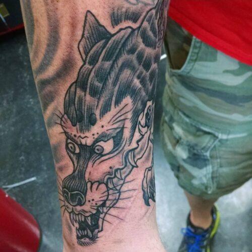 Wolf tattoo by Karl Schneider
