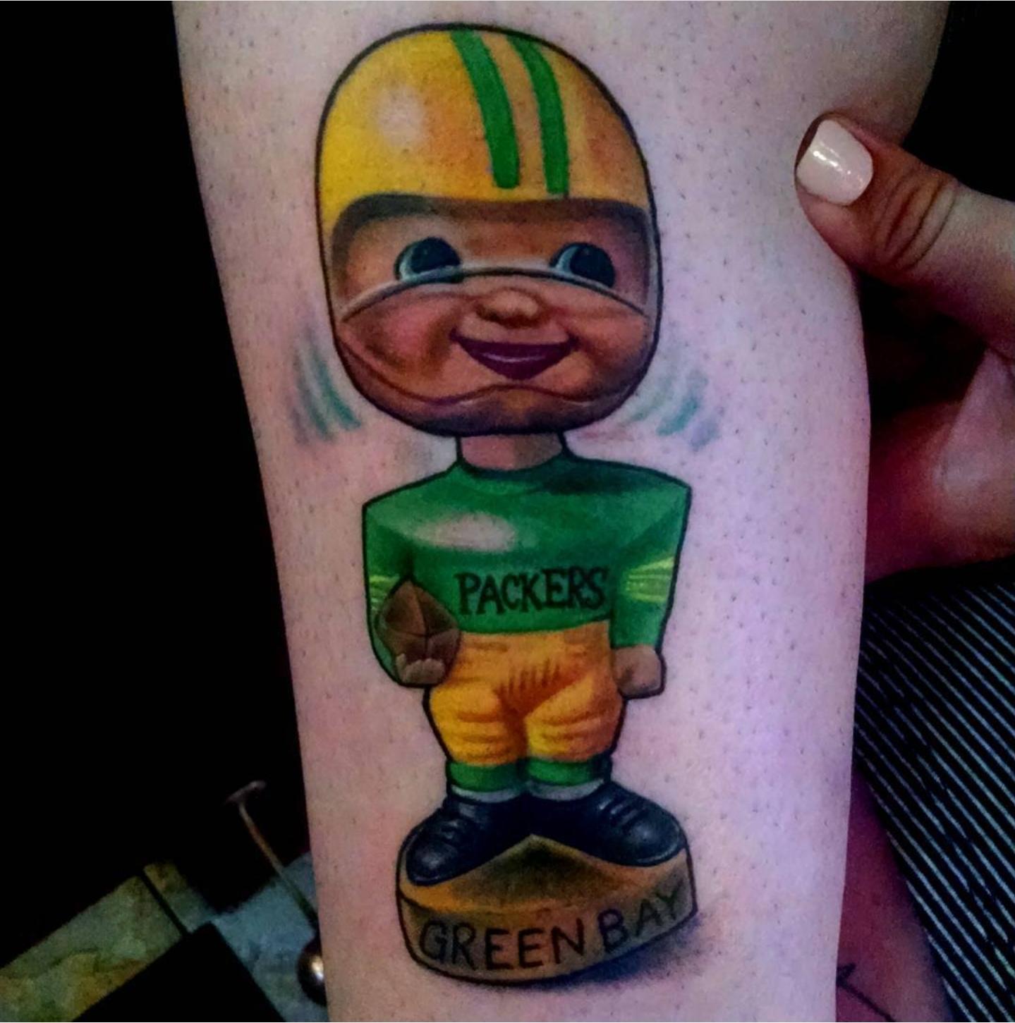 bobble head tattoo by Karl Schneider
