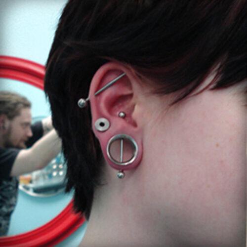 Ear piercing by Brandon Bohlman at Cactus Tattoo in Mankato