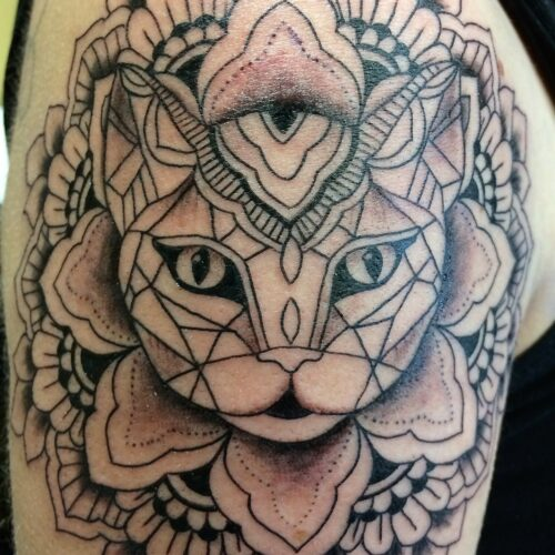 cat tattoo by Makeba Ische at Cactus Tattoo in Mankato