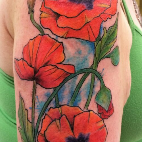 poppy flower tattoo tattoo by Makeba Ische at Cactus Tattoo in Mankato