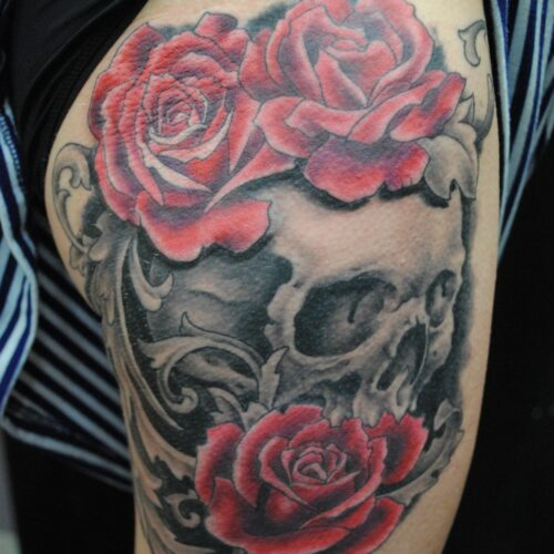 skull and flower tattoo by Rob Foster at Cactus Tattoo in Mankato