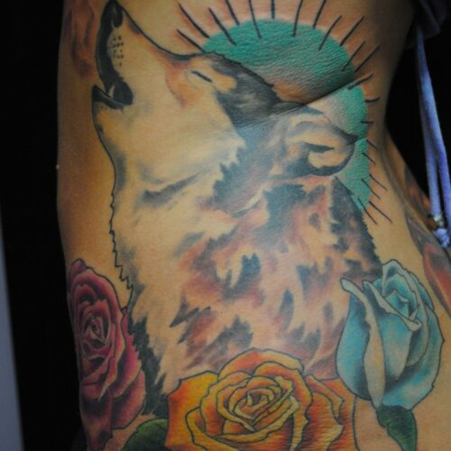 wolf and flower by Rob Foster at Cactus Tattoo in Mankato